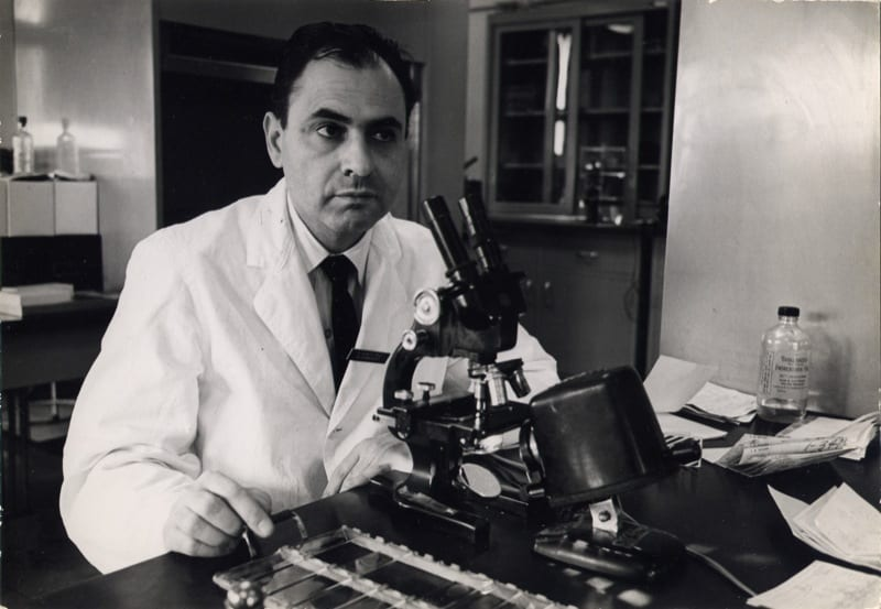 Albert Schatz in the lab at a microscope